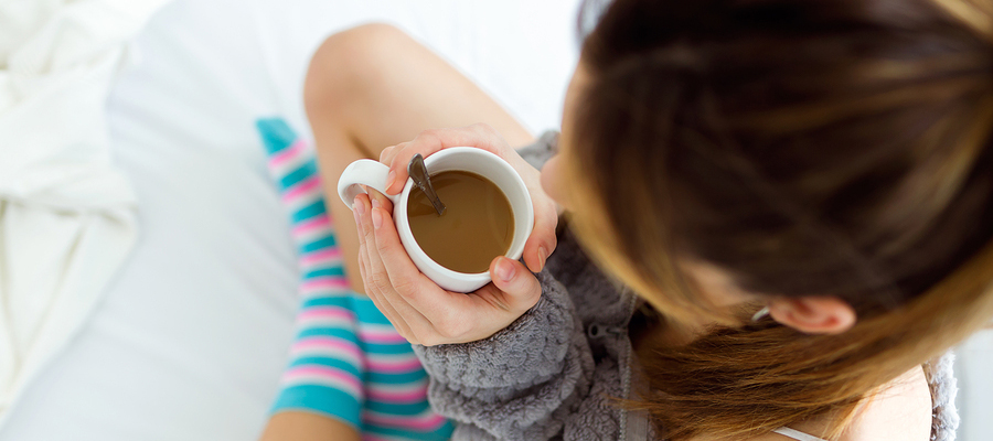 Woman with a hot cup of coffee.