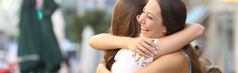 Young women hugging